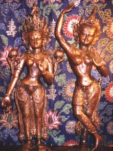 Green Tara and a dancing Dakini-  two female Buddhist figures